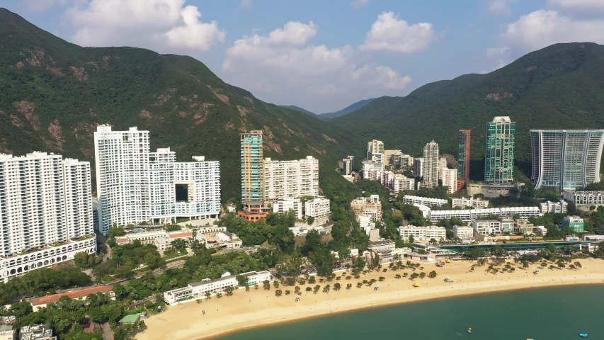 Aerial footage of the famous Repulse Bay beach and residential tower in the south of Hong Kong island on sunny day in Hongkong SAR, China | Shutterstock HD Video #1041836767