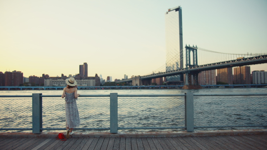 Young girl on the promenade in summer | Shutterstock HD Video #1042252687