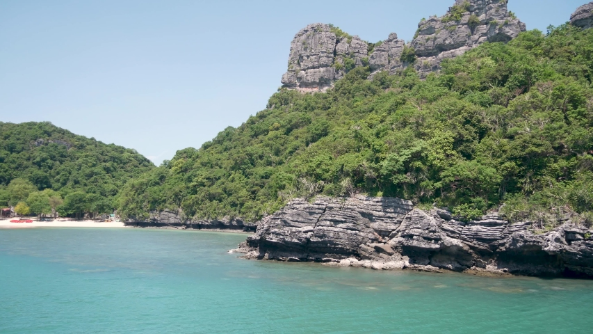 Group of Islands in ocean at Ang Thong National Marine Park near touristic Samui paradise tropical resort. Archipelago in the Gulf of Thailand. Idyllic turquoise sea natural background, copy space | Shutterstock HD Video #1042276987