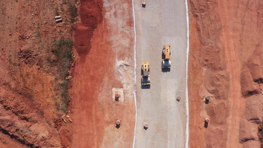 Top view of 2 rollers construction on gravel road | Shutterstock HD Video #1042317457