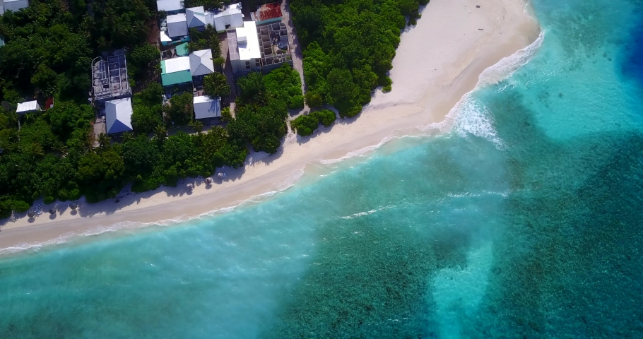 Exotic small island with palm trees and white sand beaches in crystal clear waters of Gulf of Siam ,aerial | Shutterstock HD Video #1042329517