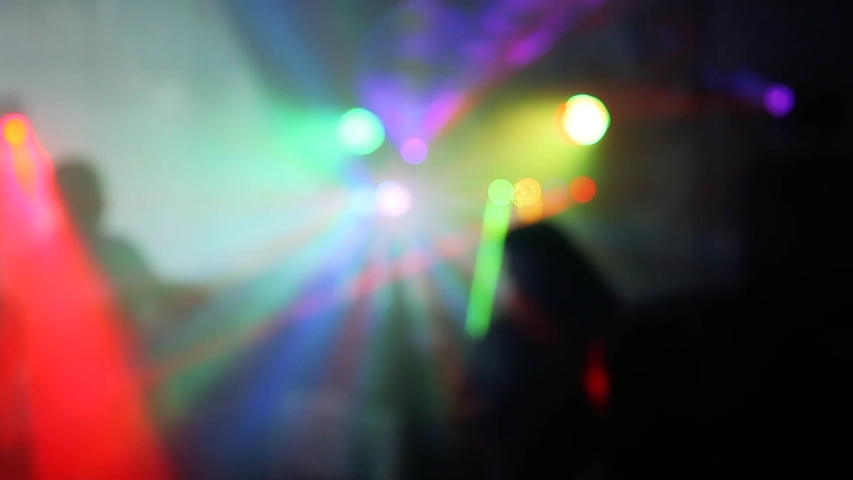 People dancing at party. Unrecognizable silhouette crowd in nightclub with disco light.  soft focus   Shutterstock HD Video #1042346287