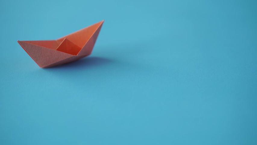 Paper boat on clean blue background with copy space, lesson and education concept   Shutterstock HD Video #1042365727