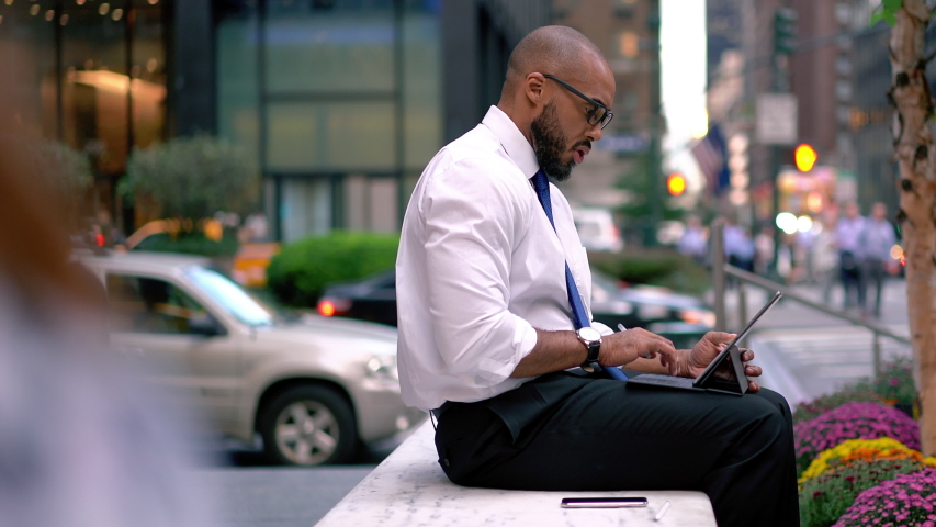 Time lapse effect of intelligent male corporate director in formal wear sitting outdoors and using touch pad for making video call and communicate with secretary,executive manager talking in downtown  | Shutterstock HD Video #1042495537