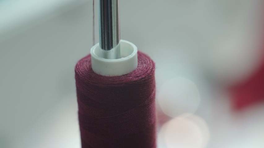 Video of rotating spool of thread | Shutterstock HD Video #1042795237