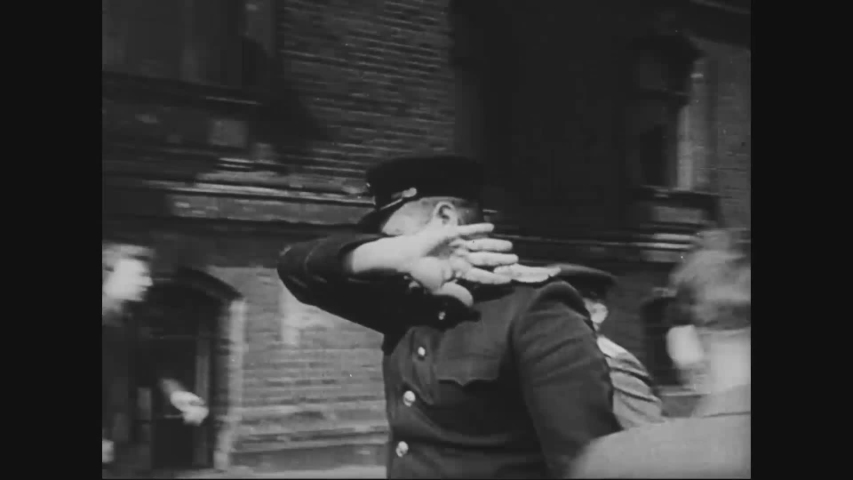 CIRCA 1940s - Nazi officials make it clear they don't want to be photographed.