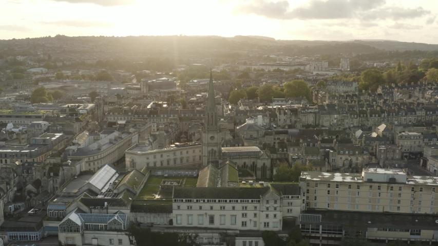 Beautiful yellow sunset over Bath city centre in Somerset. Drone panning right | Shutterstock HD Video #1043826907