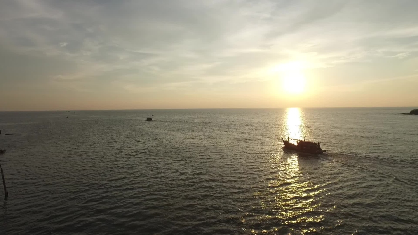 Fisherman boat going out to fish during sunset | Shutterstock HD Video #1043972797