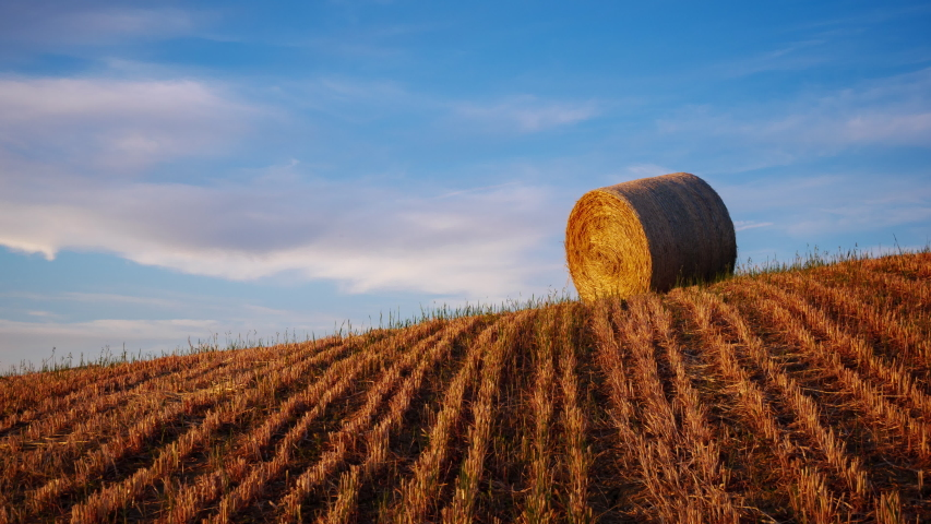 4K Time lapse of hay bales on the field at sunset, Tuscany, Italy  | Shutterstock HD Video #1044047797
