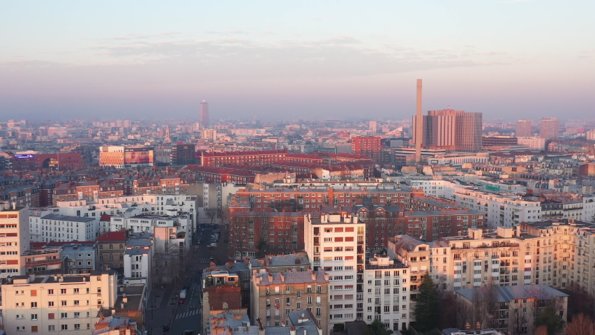 Paris hospital Bichat aerial shot sunset chimney rooftops pollution in the sky France | Shutterstock HD Video #1044656137