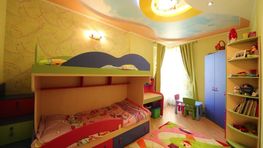 Turning on and off light in childrens room with colorful bunk bed and soft carpet