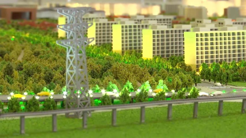 Layout of city streets, green areas, skyscrapers, buildings, power lines. Layout of the city with trees in miniature. Moving the focus from object to object. | Shutterstock HD Video #1044820237