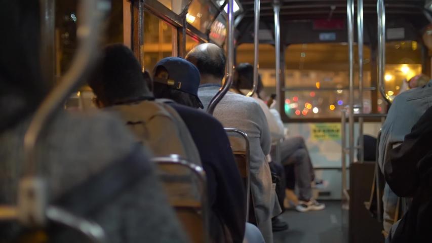 Backs of People commuting in a Tram at Nighttime 4k   Shutterstock HD Video #1044869167