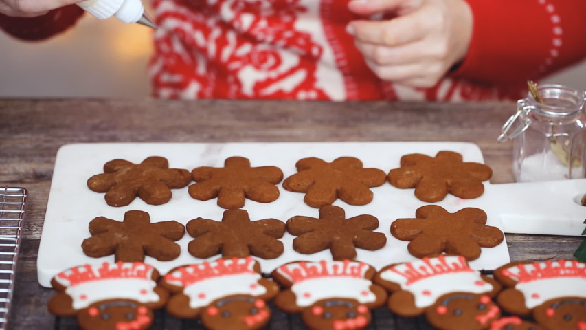 Step by step. Decorating gingerbread cookies with royal icing.   Shutterstock HD Video #1044885487