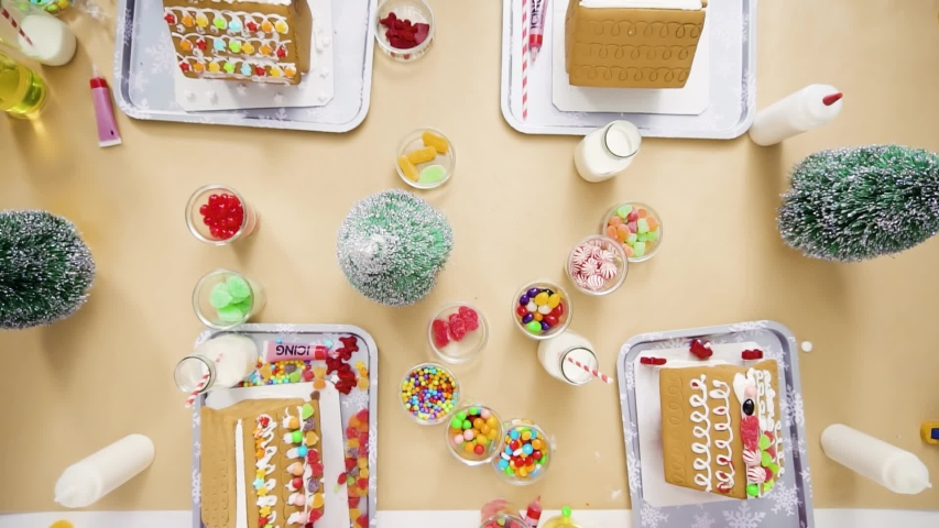 Flat lay. Step by step. Kids decorating small gingerbread houses at the Christmas craft party.   Shutterstock HD Video #1044886147