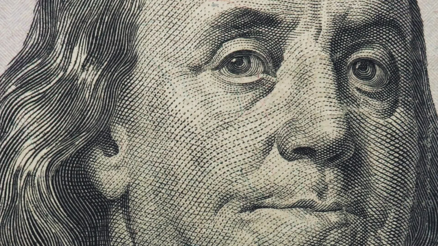 Macro of the 100US Dollars and Benjamin Frankjlin Face | Shutterstock HD Video #1044925297