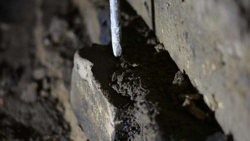 Puncher beats bricks. Construction dismantling | Shutterstock HD Video #1044926977