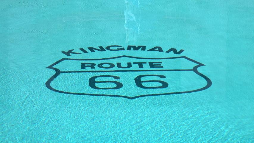 Legendary kingman route 66 headline in the swimming pool in 4k   Shutterstock HD Video #1044965377
