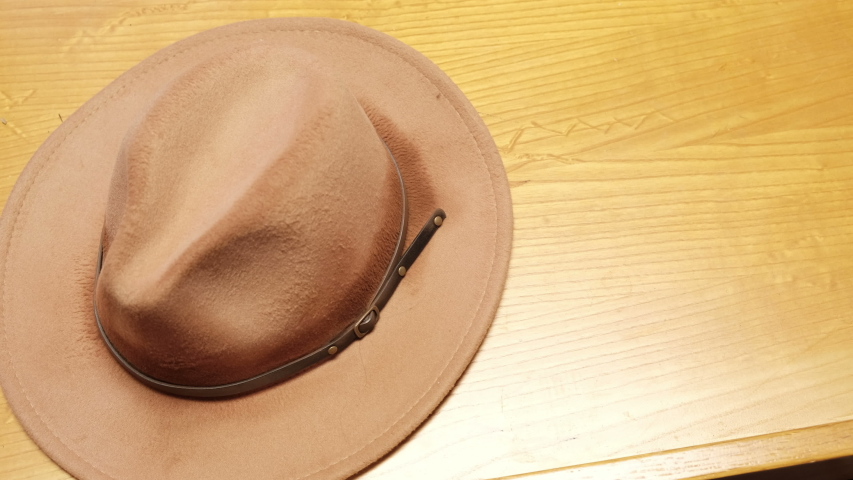 Cowboy or sheriffs hat with a revolver   Shutterstock HD Video #1045002637