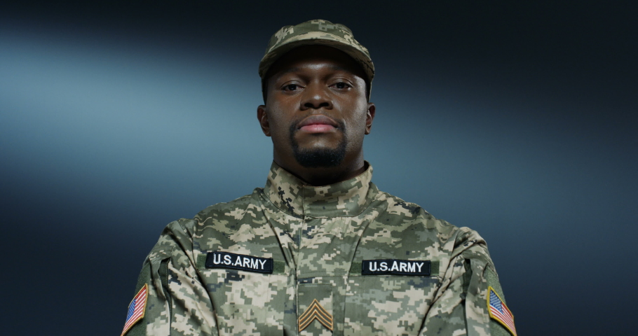Portrait shot of the strong African American male soldier of USA in army uniform and looking straight at the camera. Close up. | Shutterstock HD Video #1045021687