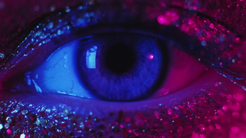 Art makeup. Beauty fashion. Woman with pink glitter skin opening eye. | Shutterstock HD Video #1045365397