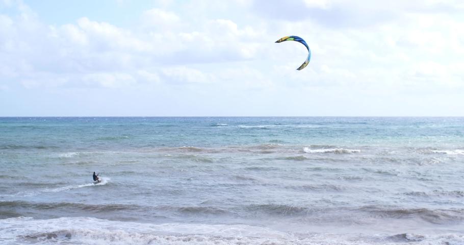 Kitesurfer kitesurf kitesurfing calm sea summer holidays extreme sport 4k | Shutterstock HD Video #1045389757