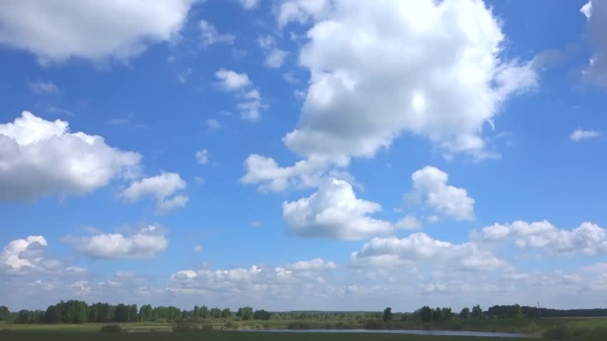 Blue sky with clouds, lake. Real time   Shutterstock HD Video #10459967