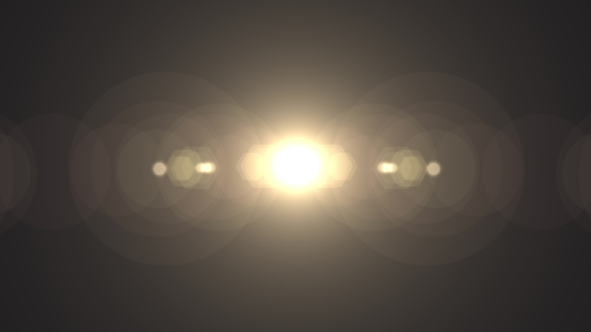 Symmetrical optical lens flares transition that is a seamless loop with natural lighting. 4K  | Shutterstock HD Video #1046319937