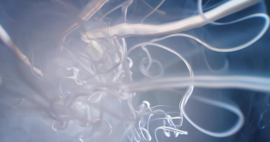 White  Fluid  in Motion underwater. Macro.  Liquids Threads. | Shutterstock HD Video #1046871247