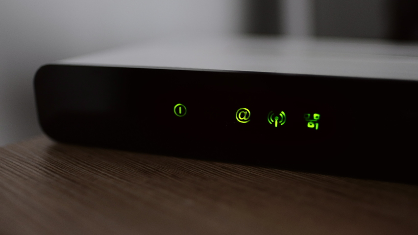 Working wifi router with lights and internet connection status.   Shutterstock HD Video #1046927437