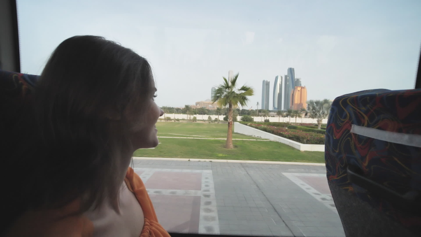 A girl travels by bus through the city of Abu Dhabi. UAE. | Shutterstock HD Video #1046983807