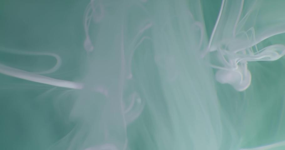 White  Fluid  in Motion underwater. Macro.  Liquids Threads. | Shutterstock HD Video #1047055177