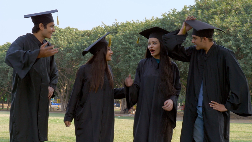 Young happy graduates throwing their graduation hats in the air - celebration time. Group of excited Indian students tossed their academic hats into the air while celebrating their graduation day -... | Shutterstock HD Video #1047111787