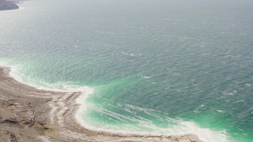 Aerial view of Dead Sea over the sea shore of Jordan,   Shutterstock HD Video #1047171787