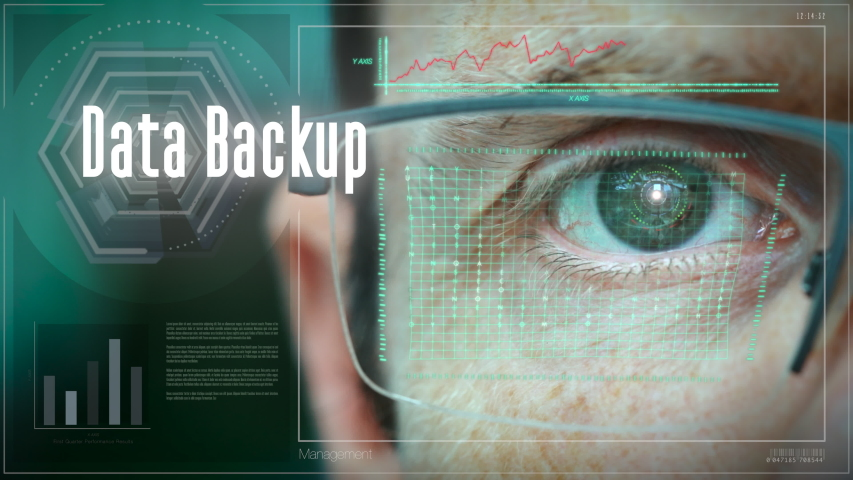 A futuristic display with with eye control and a Data Backup business concept on it. | Shutterstock HD Video #1047190087