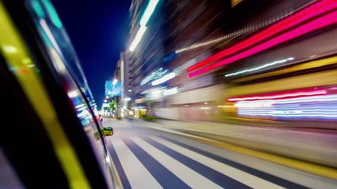 Point of view time-lapse (hyperlapse)  through the city at night by taxi. Tokyo, Japan
