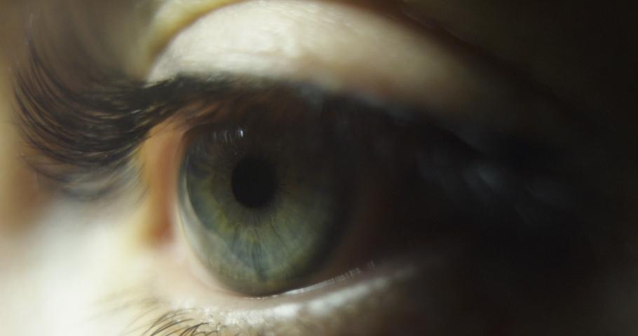 Close up beautiful eye opening woman iris macro natural beauty. Slow motion.   Shutterstock HD Video #1047249427
