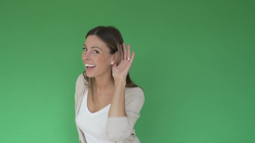Portrait of beautiful woman on green screen, listening | Shutterstock HD Video #1047332587