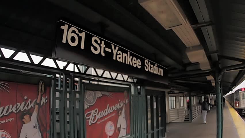 NEW YORK - FEB 9, 2010: Yankee Stadium sign, subway platform at 161 street in the bronx, 4 train entering station, NY. Yankee Stadium is home of the New York Yankees baseball franchise in NYC, USA.