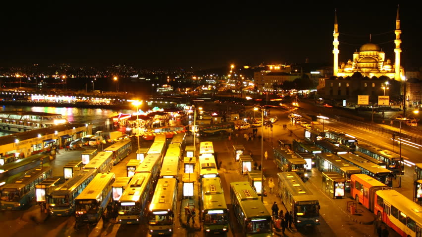 Time lapse Istanbul bus terminal at night with Mosque in background