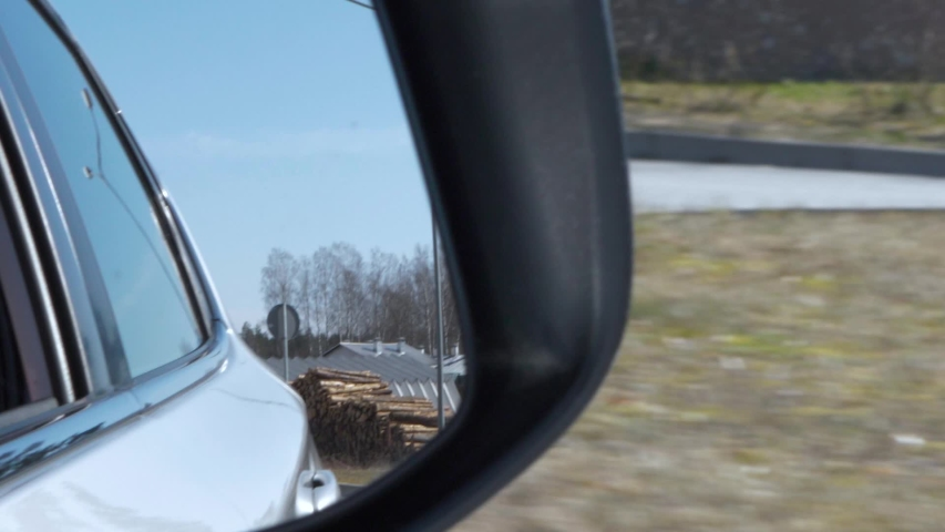 Car drive through the wood, car's side view mirror. Road Car Rear View Mirror Motion. | Shutterstock HD Video #1049258827
