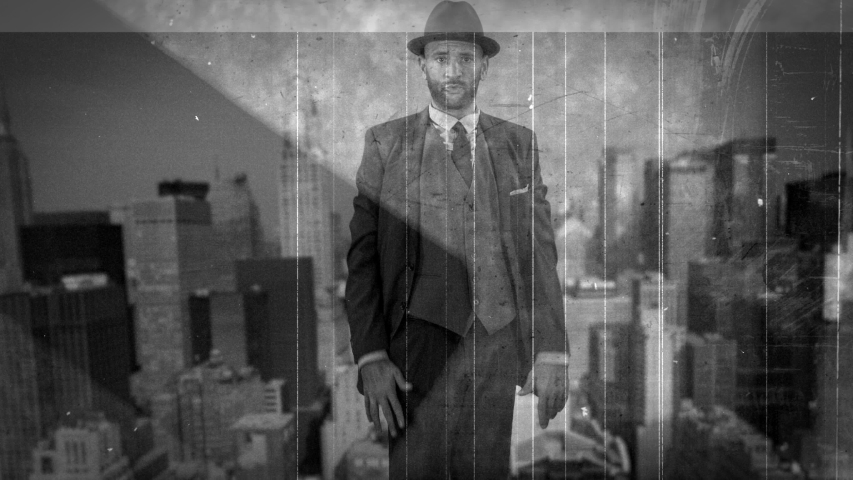 Vintage film of funky man wearing trilby hat and smart suit dancing with new york city skyline in the background. | Shutterstock HD Video #1049397697