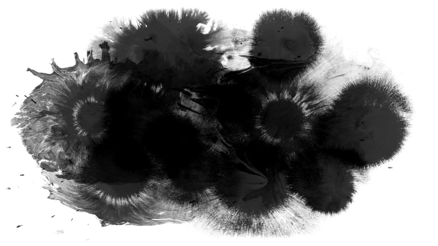 Ink blots spreading on white surface | Shutterstock HD Video #1049509357