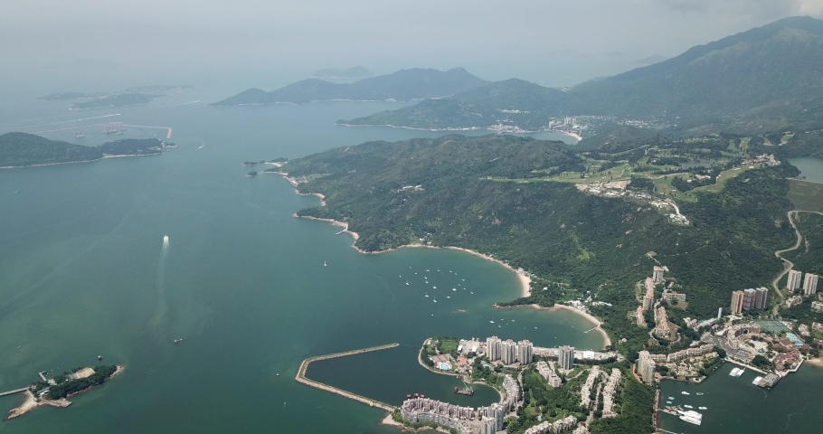 Aerial view of Discovery Bay on Lantau Island in Hong Kong | Shutterstock HD Video #1049561287