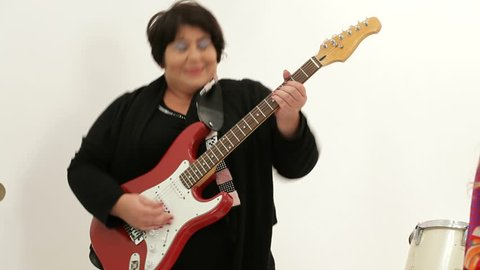 Old woman playing the electric guitar solo
