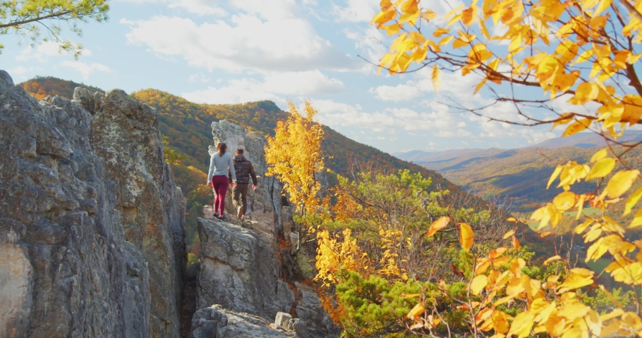Couple Walking on Rocks at Top of Seneca Rocks, Mountain Forest Landscape | Shutterstock HD Video #1049616457