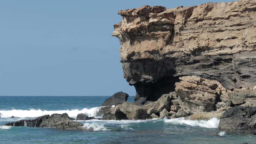 Waves crashing  on the rocky coastline of la pared, lanzarote | Shutterstock HD Video #1049813677
