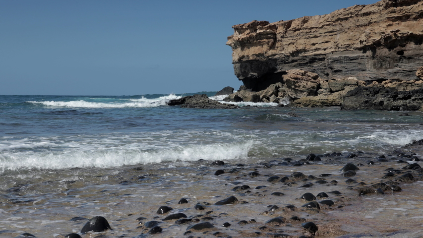 Waves crashing  on the rocky coastline of la pared, lanzarote | Shutterstock HD Video #1049820067