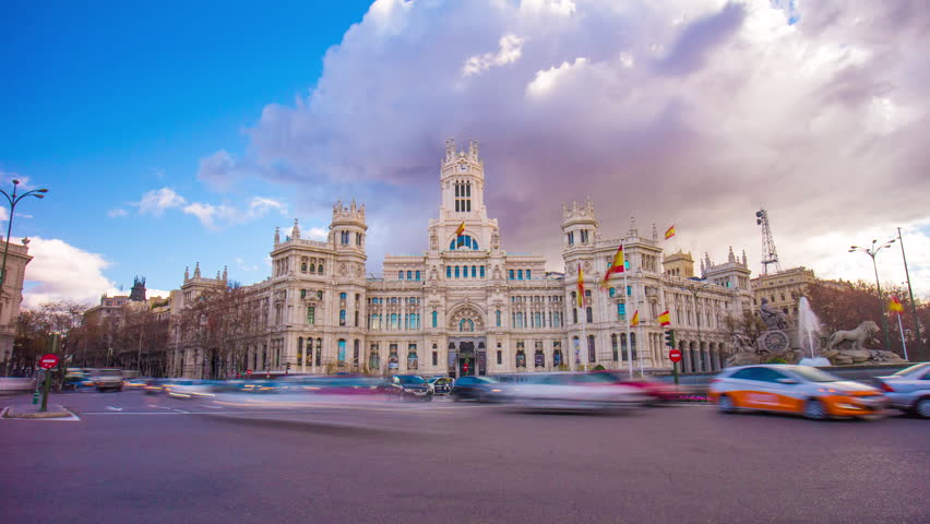 cloudy day madrid city famous post office building 4k time lapse spain