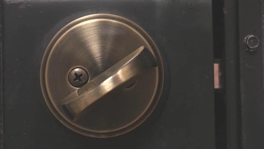 Locking a deadbolt lock on a door
